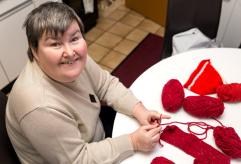 mentally disabled woman is crocheting, handiwork as a alternative therapy