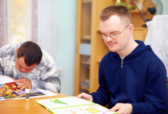 young adult men with disability engages in self study, in rehabilitation
